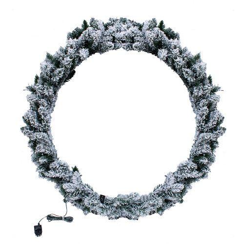 Kerstkrans met sneeuw en verlichting